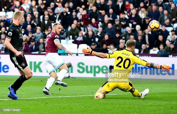 Joe Hart of Burnley saves from Marko Arnautovic of West Ham United during the Premier League match between West Ham United and Burnley FC at London...