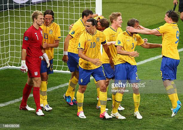 Joe Hart of England clashes with Zlatan Ibrahimovic of Sweden as Olof Mellberg scores their second goal during the UEFA EURO 2012 group D match...