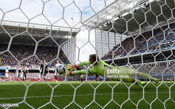 Joe Hart of England dives in vain as Gareth Bale of Wales scores his team's first goal during the UEFA EURO 2016 Group B match between England and...