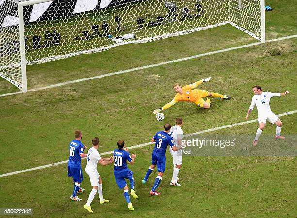 Joe Hart of England dives in vain as the ball kicked by Claudio Marchisio of Italy makes its way to the goal during the 2014 FIFA World Cup Brazil...