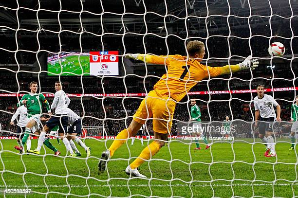 Joe Hart of England fails to stop Per Mertesacker of Germany scoring their first goal with a header during the international friendly match between...