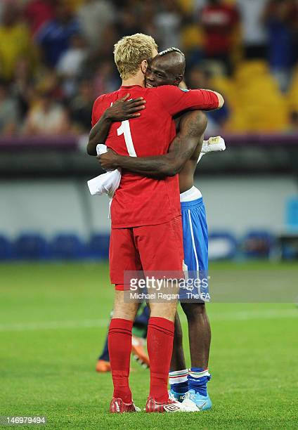 Joe Hart of England hugs Mario Balotelli of Italy after the penalty shoot out during the UEFA EURO 2012 quarter final match between England and Italy...