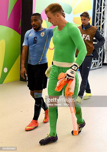 Joe Hart of England is consoled by Alvaro Pereira of Uruguay in the tunnel after the 2014 FIFA World Cup Brazil Group D match between Uruguay and...