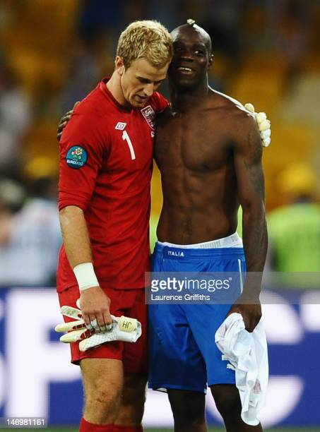 Joe Hart of England is consoled by Mario Balotelli of Italy after defeat in the penalty shoot out during the UEFA EURO 2012 quarter final match...