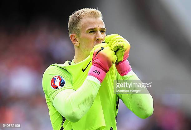 Joe Hart of England kisses the three lions badge after the UEFA EURO 2016 Group B match between England and Wales at Stade BollaertDelelis on June 16...