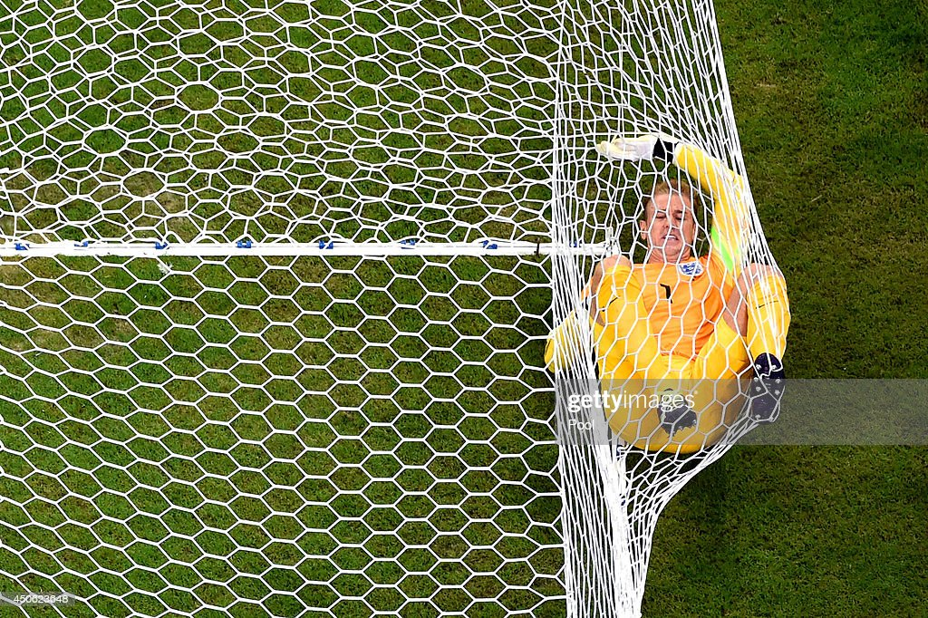 Joe Hart of England lands in the net after allowing Italy's second goal to Mario Balotelli of Italy (not pictured) during the 2014 FIFA World Cup Brazil Group D match between England and Italy at Arena Amazonia on June 14, 2014 in Manaus, Brazil.