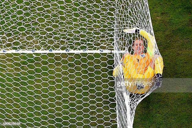 Joe Hart of England lands in the net after allowing Italy's second goal to Mario Balotelli of Italy during the 2014 FIFA World Cup Brazil Group D...