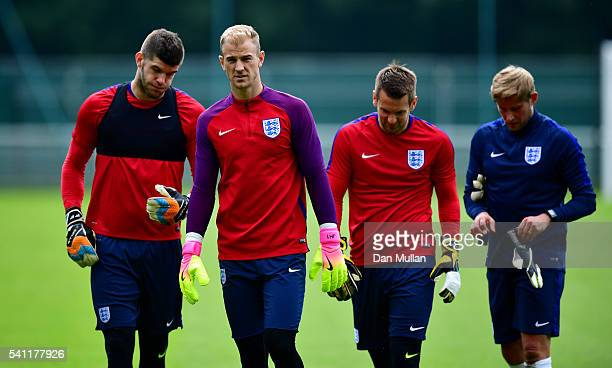 Joe Hart of England leads Fraser Forster Tom Heaton and Dave Watson Goalkeeping Coach of England during a training session ahead of the UEFA Euro...