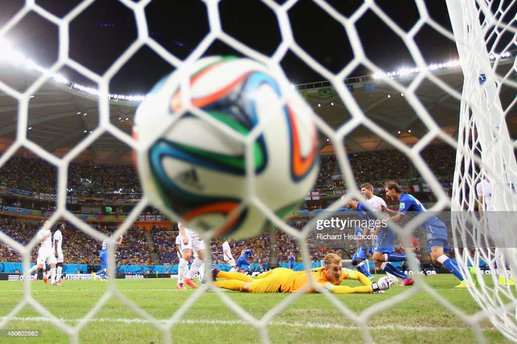Joe Hart of England lies on the pitch after Claudio Marchisio of Italy (not pictured) kicked the ball and scored the first goal into the first half during the 2014 FIFA World Cup Brazil Group D match between England and Italy at Arena Amazonia on June 14, 2014 in Manaus, Brazil.