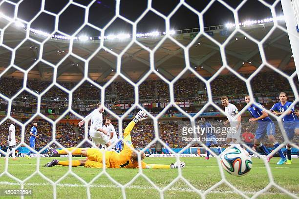 Joe Hart of England lies on the pitch after Claudio Marchisio of Italy kicked the ball and scored the first goal into the first half during the 2014...
