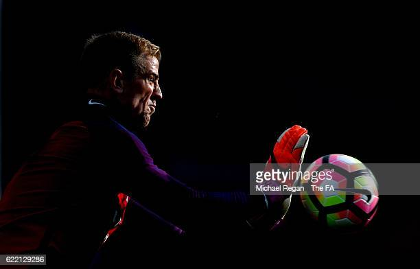 Joe Hart of England makes a save during a training session ahead of the FIFA 2018 World Cup qualifying group F match against Scotland at St George's...