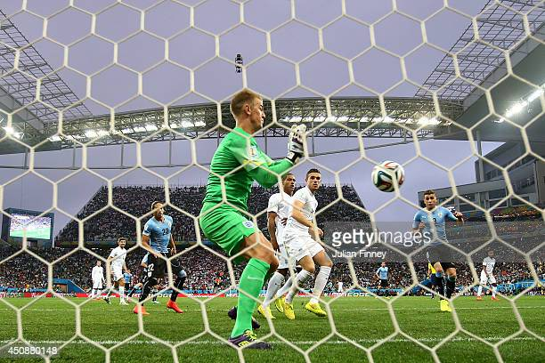 Joe Hart of England makes a save during the 2014 FIFA World Cup Brazil Group D match between Uruguay and England at Arena de Sao Paulo on June 19...