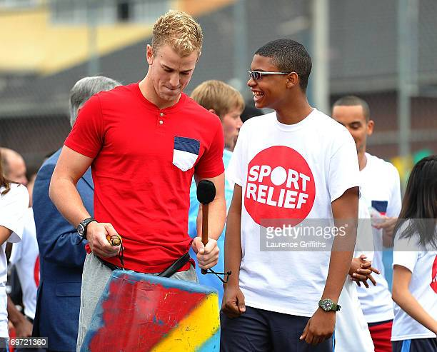 Joe Hart of England plays the drums with local children during a visit to a Sport Relief project on May 31 2013 in Rio de Janeiro Brazil