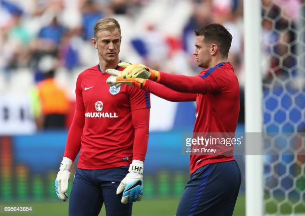 Joe Hart of England talks with Tom Heaton prior to the International Friendly match between France and England at Stade de France on June 13 2017 in...