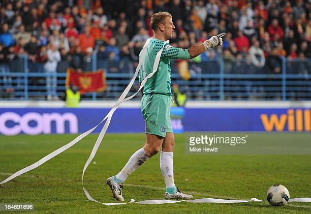 Joe Hart of England untangles a toilet roll from his head during the FIFA 2014 World Cup Group H Qualifier between Montenegro and England at City...