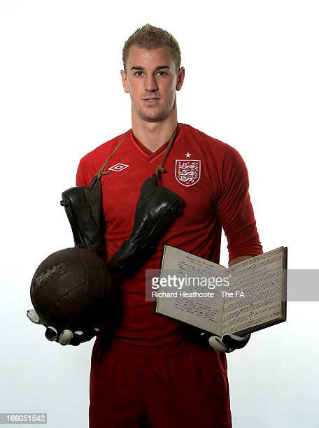 Joe Hart of Manchester City and England poses with the original FA 150 minute book and ball and boots from the era during the FA's 150th Anniversary...