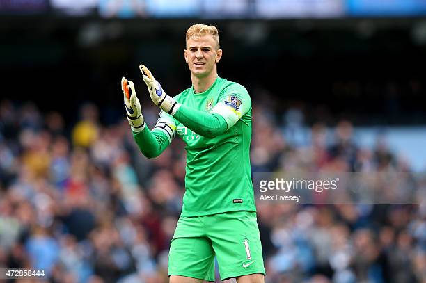 Joe Hart of Manchester City applauds the fans during the Barclays Premier League match between Manchester City and Queens Park Rangers at the Etihad...
