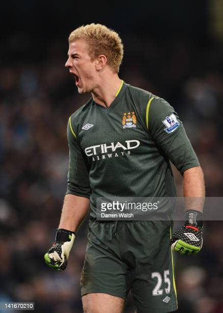 Joe Hart of Manchester City celebrates during the Barclays Premier League match between Manchester City and Chelsea at the Etihad Stadium on March 21...