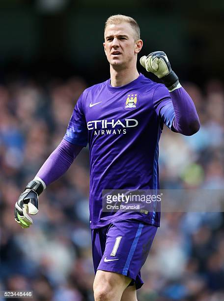 Joe Hart of Manchester City celebrates his sides third goal during the Barclays Premier League match between Manchester City and Stoke City at Etihad...