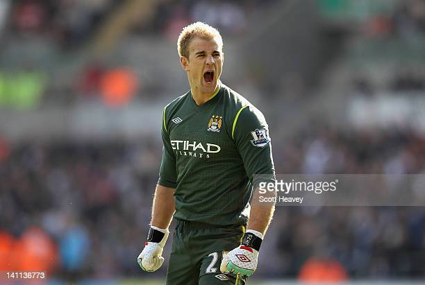 Joe Hart of Manchester City celebrates saving a penalty kick during the Barclays Premier League match between Swansea City and Manchester City at the...