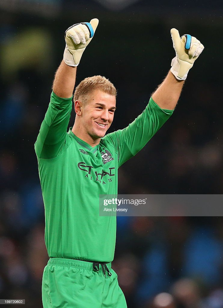 Joe Hart of Manchester City celebrates towards his supporters after the Barclays Premier League match between Manchester City and Fulham at Etihad Stadium on January 19, 2013 in Manchester, England.