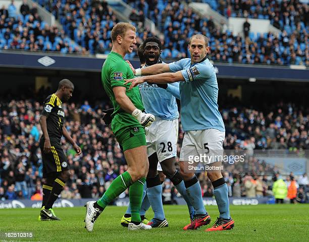 Joe Hart of Manchester City celebrates with teammates Pablo Zabaleta and Kolo Toure after saving a penalty during the Barclays Premier League match...
