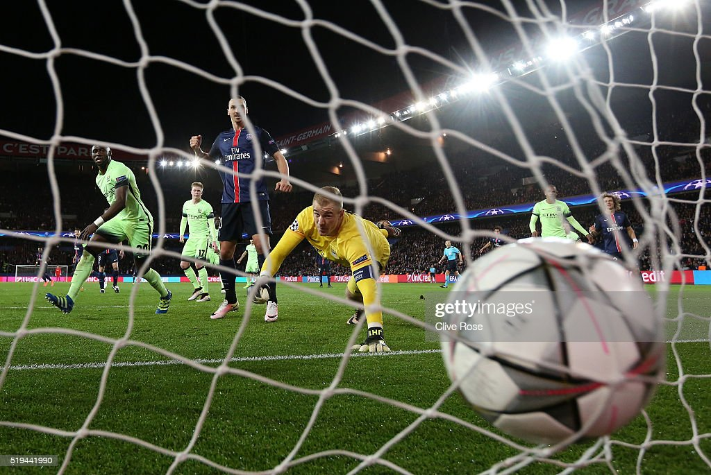 Joe Hart of Manchester City dives in vain as Adrien Rabiot (not pictured) of Paris Saint-Germain scores his team's second goal during the UEFA Champions League Quarter Final First Leg match between Paris Saint-Germain and Manchester City at Parc des Princes on April 6, 2016 in Paris, France.