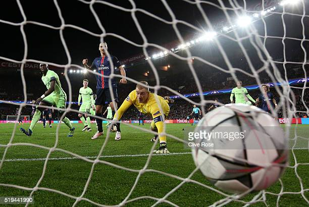 Joe Hart of Manchester City dives in vain as Adrien Rabiot of Paris SaintGermain scores his team's second goal during the UEFA Champions League...