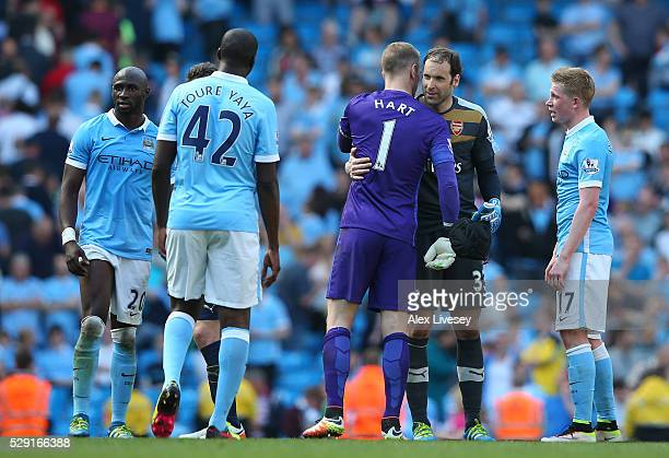 Joe Hart of Manchester City embraces Petr Cech of Arsenal following the Barclays Premier League match between Manchester City and Arsenal at the...