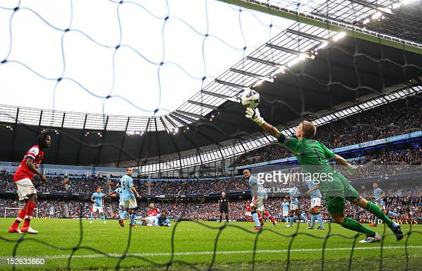 Joe Hart of Manchester City fails to save Laurent Koscielny of Arsenal's goal during the Barclays Premier League match between Manchester City and...