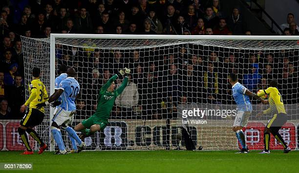 Joe Hart of Manchester City fails to stop a deflected corner from Ben Watson of Watford for his side's first goal during the Barclays Premier League...