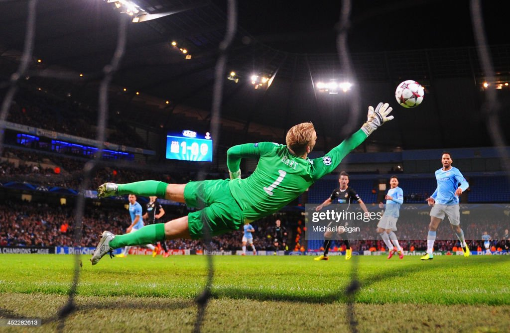Joe Hart of Manchester City fails to stop a shot by Tomas Horava (blocked) of Plzen during the UEFA Champions League Group D match between Manchester City and FC Viktoria Plzen at Etihad Stadium on November 27, 2013 in Manchester, England.