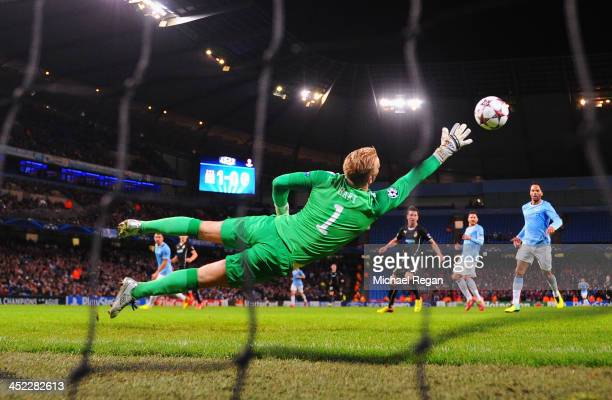 Joe Hart of Manchester City fails to stop a shot by Tomas Horava of Plzen during the UEFA Champions League Group D match between Manchester City and...