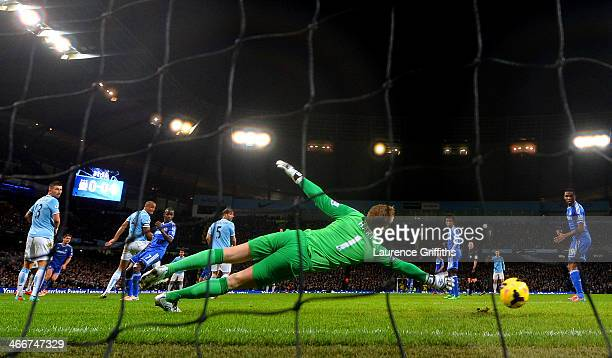 Joe Hart of Manchester City fails to stop Branislav Ivanovic of Chelsea scoring the opening goal during the Barclays Premier League match between...