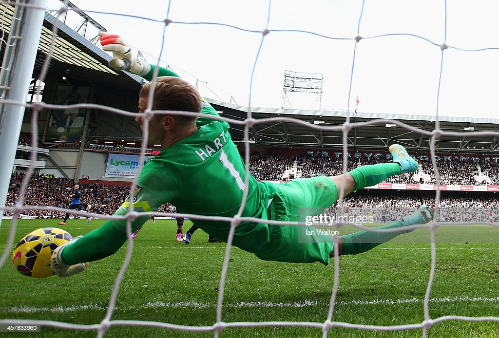 Joe Hart of Manchester City fails to stop the header by Diafra Sakho of West Ham United during the Barclays Premier League match between West Ham United and Manchester City at Boleyn Ground on October 25, 2014 in London, England.