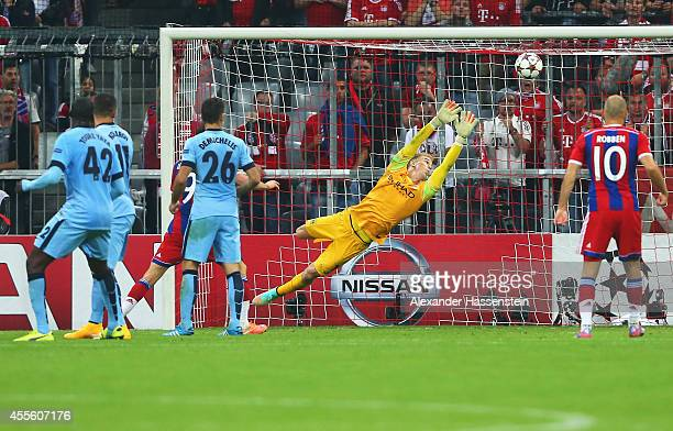 Joe Hart of Manchester City fails to stop the shot by Jerome Boateng of Bayern Muenchen for the opening goal during the UEFA Champions League Group E...