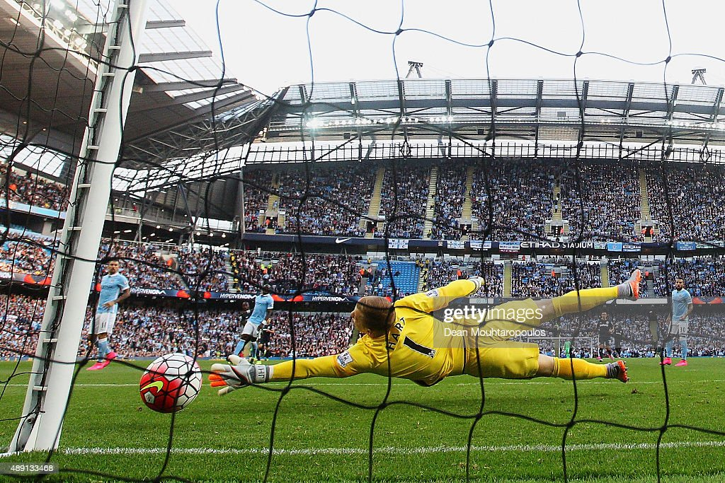 Joe Hart of Manchester City fails to stop Victor Moses of West Ham United (not pictured) from scoring the opening goal during the Barclays Premier League match between Manchester City and West Ham United at Etihad Stadium on September 19, 2015 in Manchester, United Kingdom.