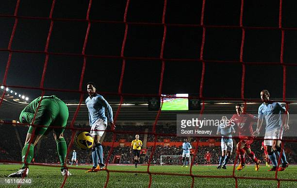 Joe Hart of Manchester City lets the ball go through his legs which leads to Steven Davis of Southampton tapping the ball in to score their second...