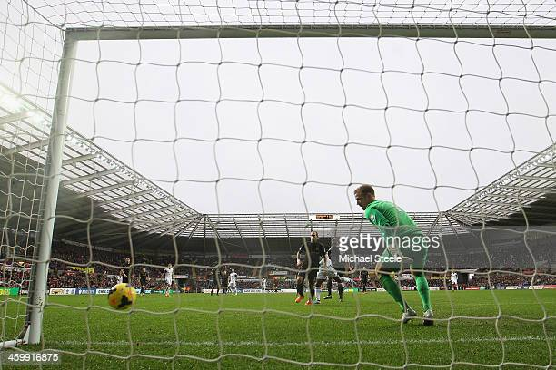 Joe Hart of Manchester City looks back as Wilfried Bony of Swansea City scores his sidesopening goal during the Barclays Premier League match between...
