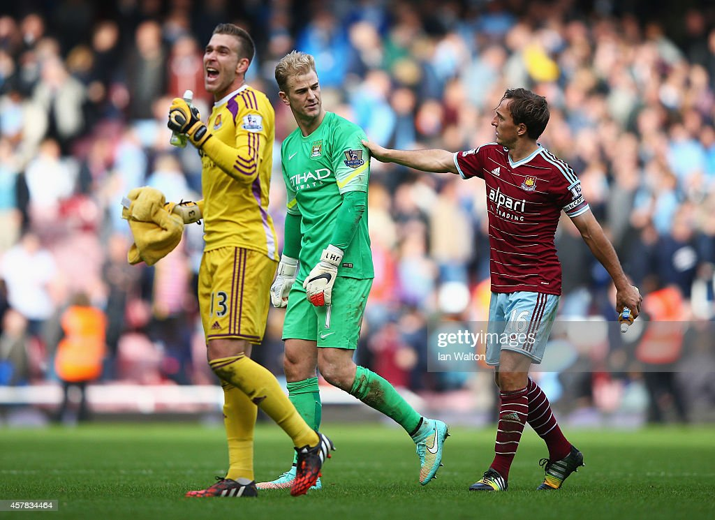 Joe Hart of Manchester City looks dejected as he is consoled by Mark Noble of West Ham United as Adrian of West Ham United celebrates after the Barclays Premier League match between West Ham United and Manchester City at Boleyn Ground on October 25, 2014 in London, England.