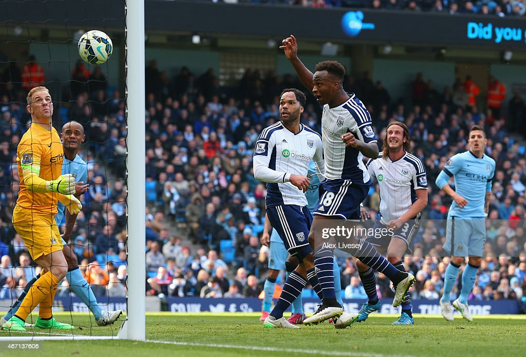Joe Hart of Manchester City looks on as Saido Berahino of West Brom hits the cross bar during the Barclays Premier League match between Manchester City and West Bromwich Albion at Etihad Stadium on March 21, 2015 in Manchester, England.