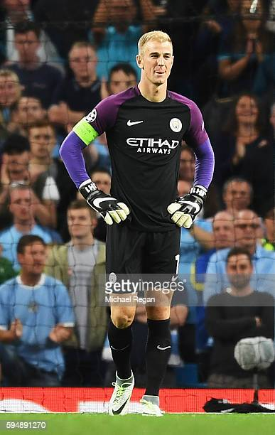 Joe Hart of Manchester City looks on during the UEFA Champions League Playoff Second Leg match between Manchester City and Steaua Bucharest at Etihad...