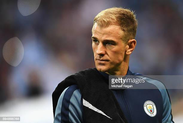 Joe Hart of Manchester City looks on prior to the UEFA Champions League Playoff Second Leg match between Manchester City and Steaua Bucharest at...