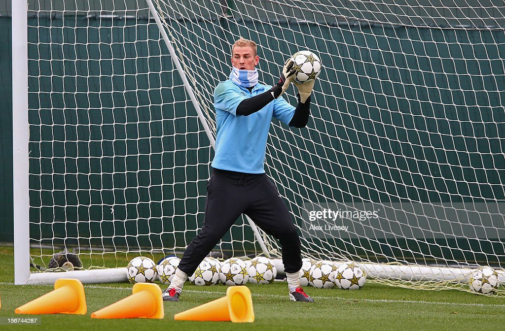Joe Hart of Manchester City makes a save during a training session at Carrington Training Ground on November 20, 2012 in Manchester, England.