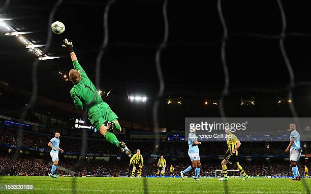Joe Hart of Manchester City makes a save during the UEFA Champions League Group D match between Manchester City and Borussia Dortmund at the Etihad...
