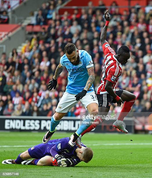 Joe Hart of Manchester City makes a save from Sadio Mane of Southampton with Nicolas Otamendi of Manchester City during the Barclays Premier League...