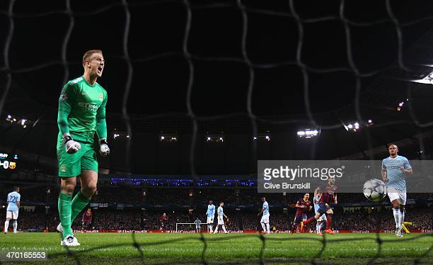 Joe Hart of Manchester City reacts after Lionel Messi of Barcelona scored the opening goal from a penalty kick during the UEFA Champions League Round...