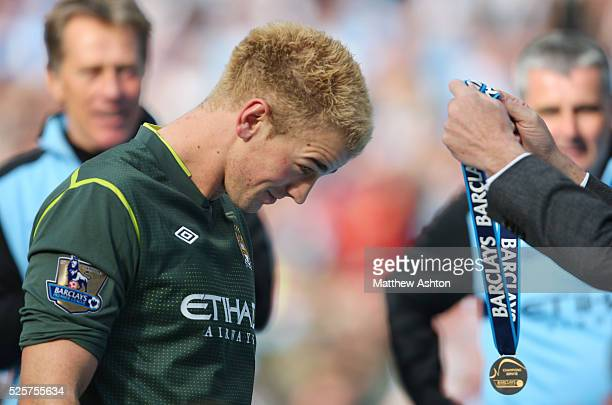 Joe Hart of Manchester City receives his winners medal after Manchester City become champions of the Barclays Premier League 2011/12
