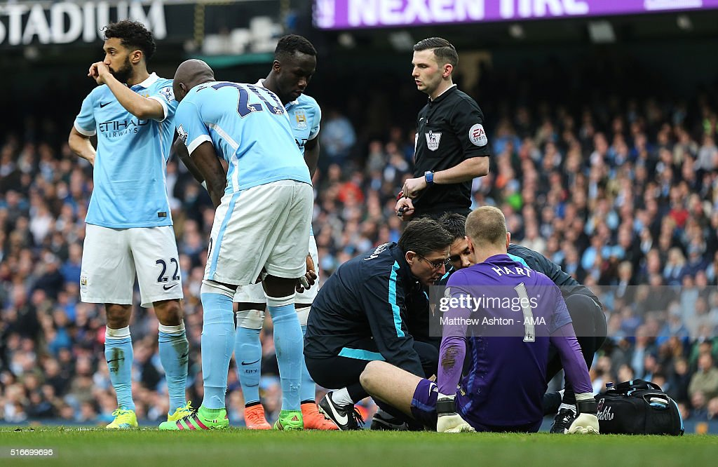 Joe Hart of Manchester City receives treatment for an injury during the Barclays Premier League match between Manchester City and Manchester United at the Etihad Stadium on March 20, 2016 in Manchester, England.