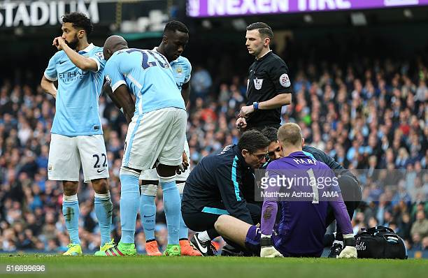 Joe Hart of Manchester City receives treatment for an injury during the Barclays Premier League match between Manchester City and Manchester United...